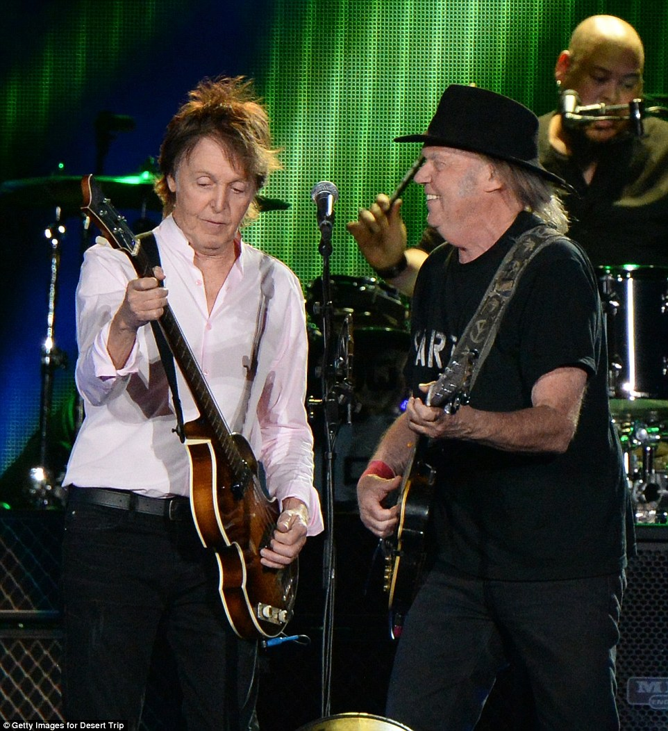 Goof time pals: The two guitarists played together standing face to face
