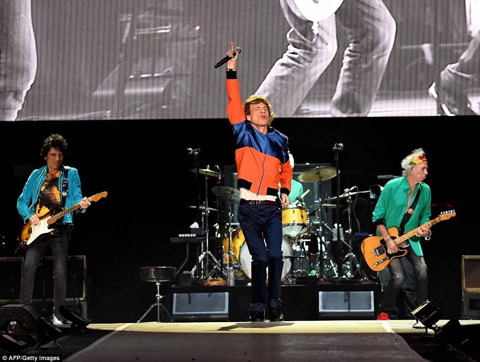 Satisfaction: Mick and Keith are joined by Ronnie Wood (left) and Charlie Watts (behind Jagger on drums)