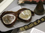 In this Tuesday, Oct. 4, 2016 photo a pair of goggles once worn by a Japanese pilot in the Dec. 7, 1941 attack on Pearl Harbor is on display part of an exhibit at The Museum of World War II, Boston, in Natick, Mass. The new exhibition, which opened Saturday, Oct. 8, features artifacts that have rarely been publicly displayed. (AP Photo/Steven Senne)