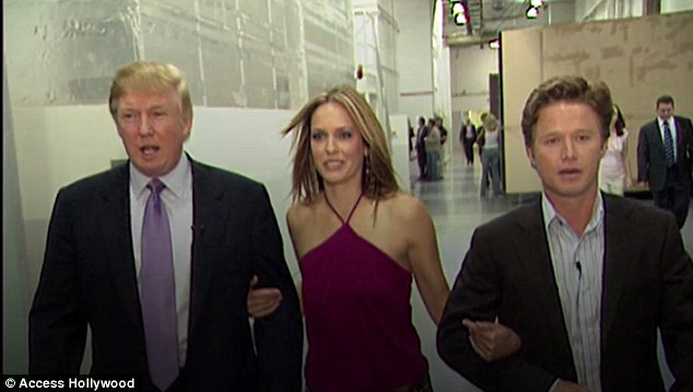 Arianne Zucker (middle) walks between Donald Trump and Billy Bush moments after Bush referred to her as 'hot' in a hot-mic recording in 2005