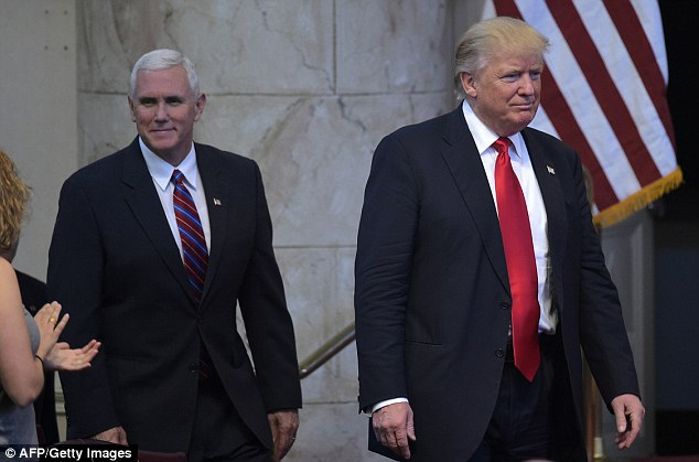 Pence has been under pressure to drop out as Trump's running mate since the businessman was heard making lewd comments about women in a 2005 tape  recording. They are seen above together last month