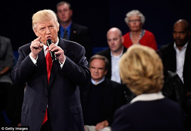 Trump lashes out at Clinton during the town hall debate at Washington University on Sunday