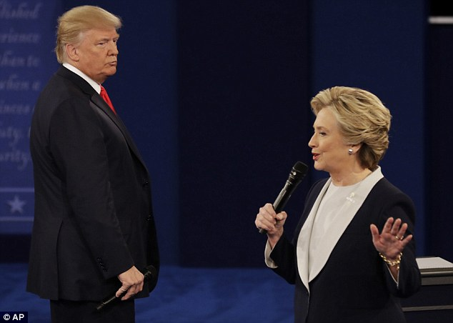 Trump circled his opponent as she spoke, pacing the floor with his microphone held tightly in one hand
