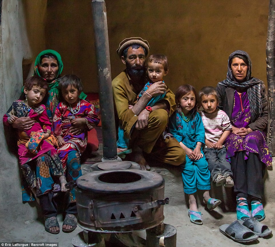 An Afghan family in front of a stove in Wakhan. The Wakhan corridor is home to about 12,000 people, some of whom have no idea the Taliban took power