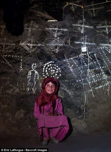 Afghan girl inside a traditional Pamiri house decorated for Nowruz