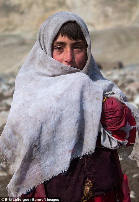 A Wakhi nomad girl. There is little to distract these children and tourists provide some entertainment