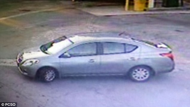 Authorities say Hogs is driving a stolen grey 2012 Nissan Versa with an Alabama handicapped plate 4JL26 (above)