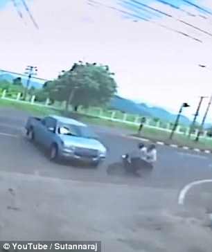 In a horrific crash in Thailand a truck turns into a motorcyclist and his passenger
