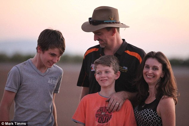 Cameron (centre, with his family) was shaken and had to take antibiotics  but will recover