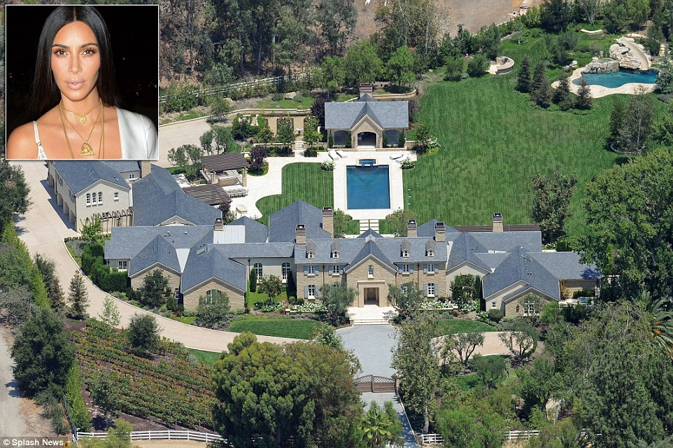 Jolie's new home is less than a mile away from a lavish mansion (above) owned by Kim Kardashian and Kanye West