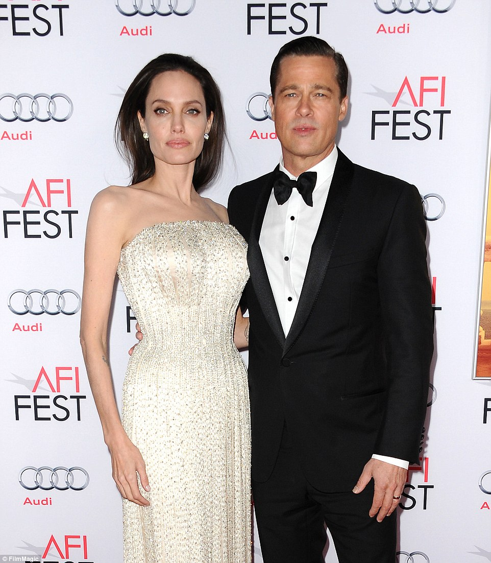 Angelina Jolie moved her children from Malibu to Hidden Hills after filing for divorce from husband Brad Pitt (together, above)