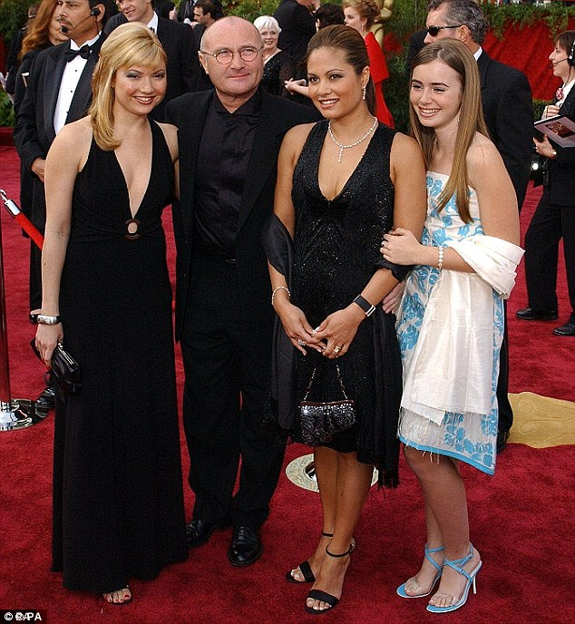 Phil Collins and Orianne pictured together at the 2004 Oscars with his daughters Joely (left) and Lily (right)