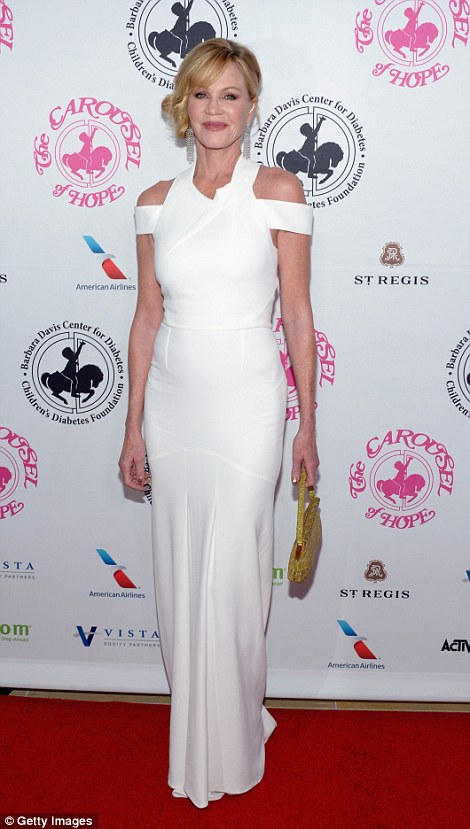 The fifty something stunned in a cutaway white dress at the charity gala