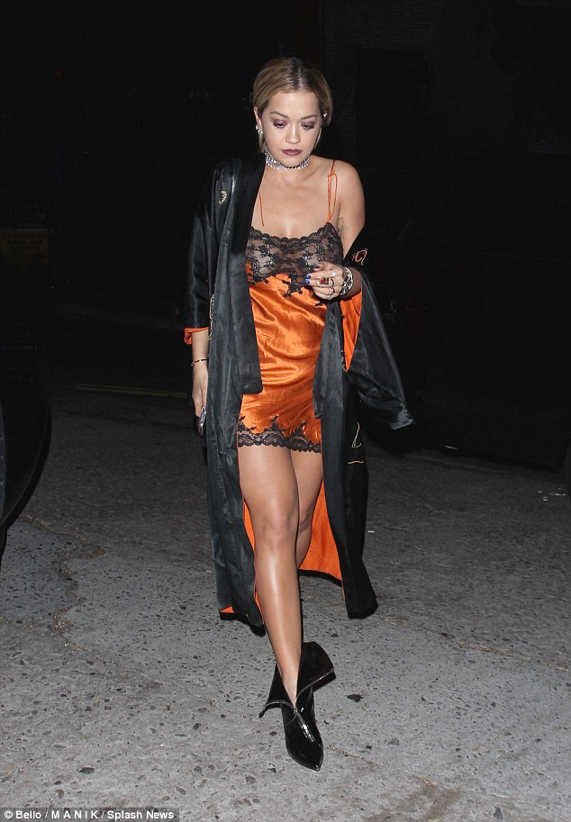 Racy: Wearing a risqué negligée-style mini dress with a sheer panel across her chest, the 25-year-old British singer gave onlookers more than they bargained for
