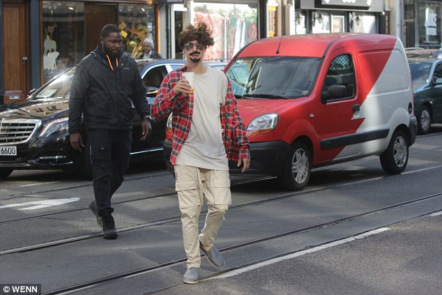Who's that guy? Bieber wore simple combat trousers and a plaid shirt