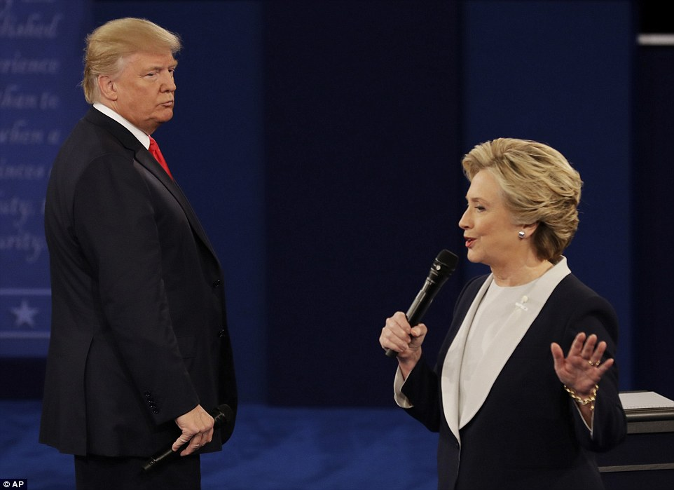 Republican presidential nominee Donald Trump glares at Democratic presidential nominee Hillary Clinton as she speaks