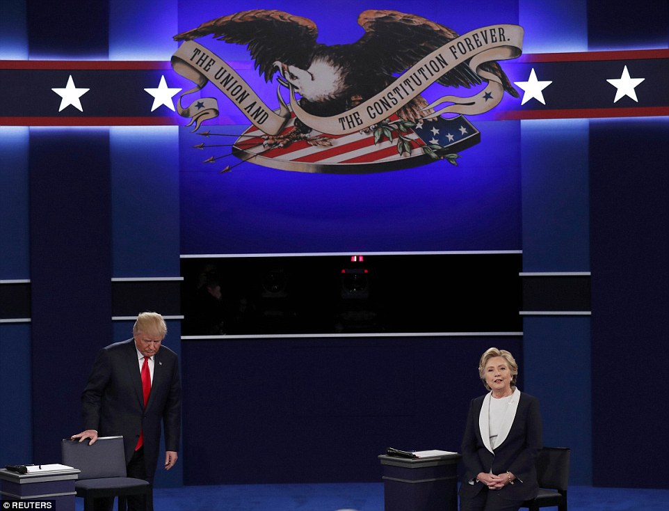 Republican U.S. presidential nominee Donald Trump and Democratic U.S. presidential nominee Hillary Clinton take the stage at the start of their presidential town hall debate