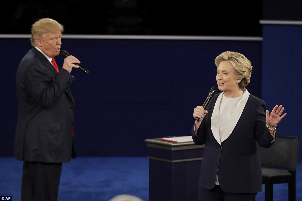 Republican nominee Donald Trump interrupts Hillary Clinton as she answers a question during the second presidential debate
