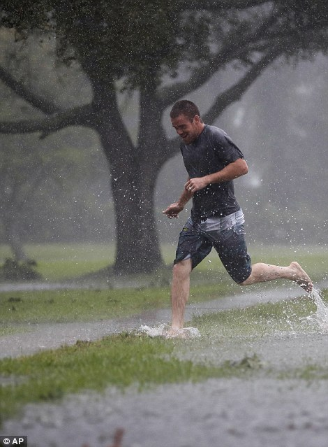 Nice weather for a run? Austin Massett runs through an area beginning to flood close to St Augustine, Florida