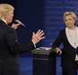 Democratic presidential nominee Hillary Clinton listens to Republican presidential nominee Donald Trump during the second presidential debate at Washington University in St. Louis, Sunday, Oct. 9, 2016. (AP Photo/John Locher)