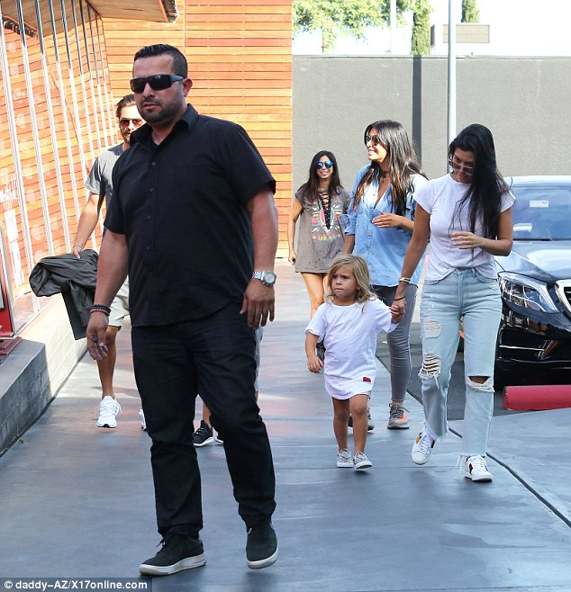 Family outing: Kourtney Kardashian and Scott Disick stepped out under the watchful eye of a bodyguard as they spent time with Mason and Penelope in Calabasas on Sunday