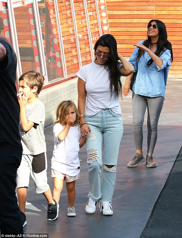 Doting mom: Kourtney held tight to four-year-old Penelope's hand