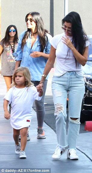 Stylish: Kourtney wore a classic white Tshirt tucked into ripped jeans