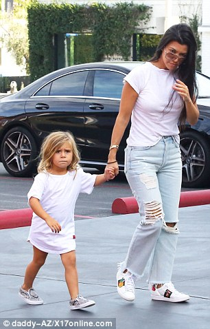 Mommy and me: Penelope held her mom's hand during the family's outing in Calabasas