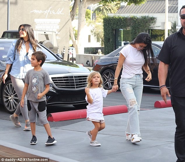 Family time: Kourtney's son Mason, six, wore a grey Tshirt and shorts