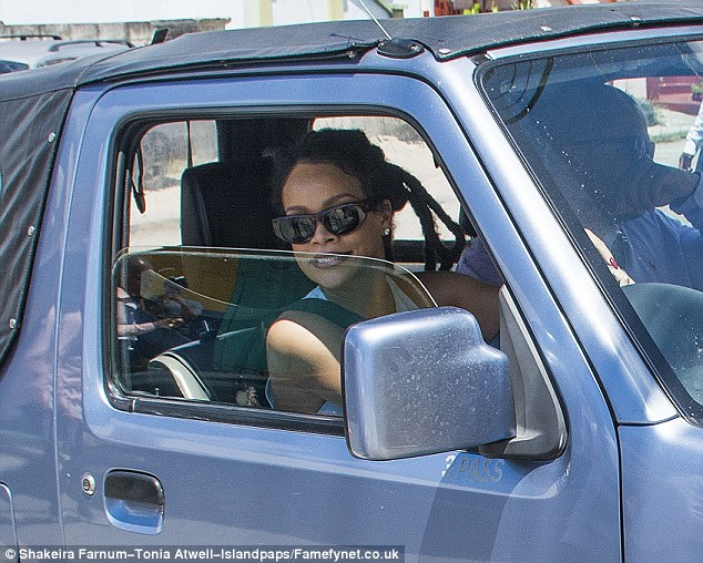 Taking the wheel! Rihanna pulled up in a small silver SUV