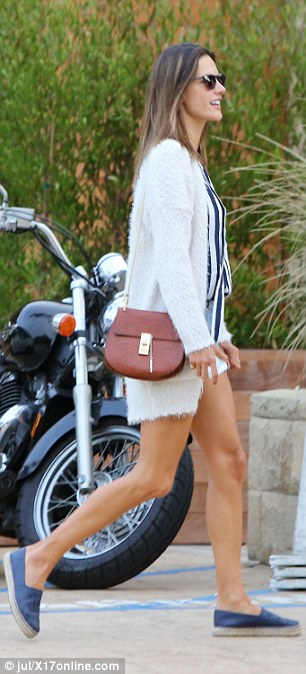 Cosy: The Brazilian beauty layered a cream sweater over the laid-back ensemble and stepped out in a pair of navy slip-ons