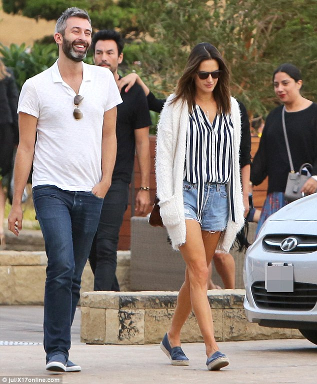 Slender star: Alessandra tucked her buttoned-down top into the distressed Daisy Dukes which highlighted her slim waistline