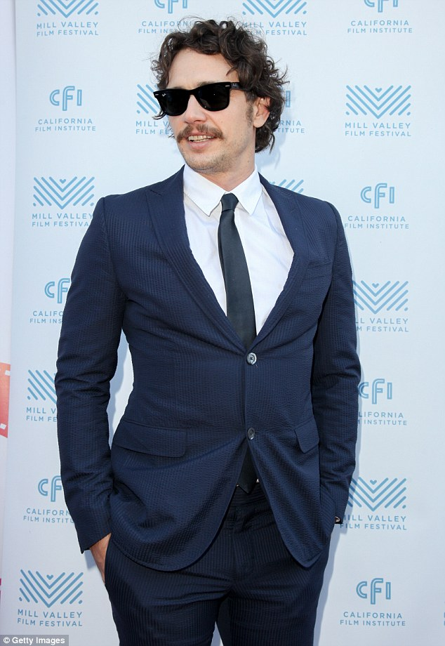 Relaxed:His curly locks were worn down and dishevelled as he rocked a mustache for the occasion