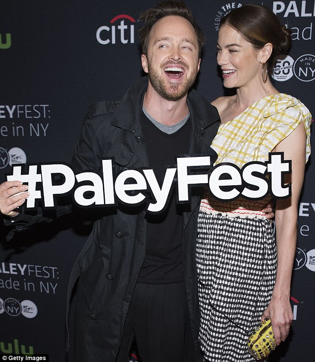 Shameless: The Breaking Bad star hammed it up as he held a sign promoting the event