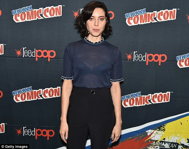 Ooh la la: The racy top put her black bra on display