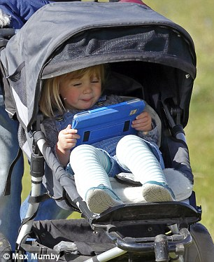 Mia, two, stared intently at her screen at an event where her mother, Zara, competed