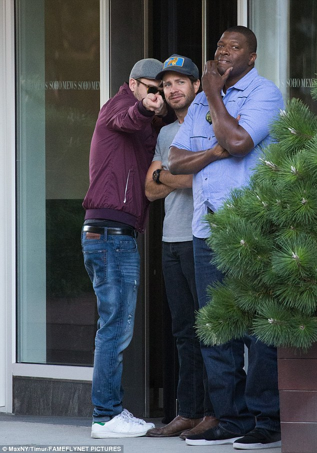 See that?: The 35-year-old singer-actor-dancer was spotted chatting and pointing out something to his two pals