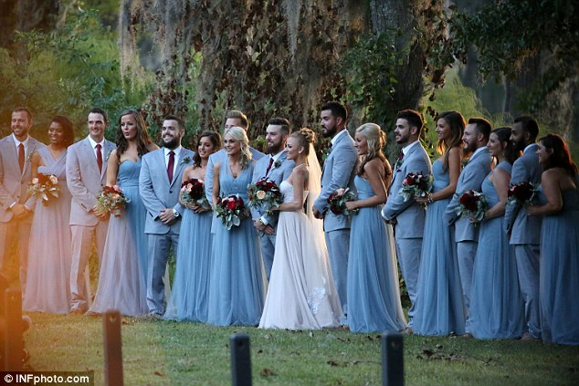Wedding party: Maci and Taylor were joined by family and friends, with the bridesmaid's wearing blue dresses with a one-shouldered design