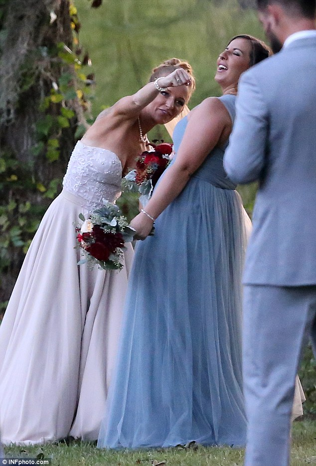 Knockout! Maci goofed around with a bridesmaid, who wore a blue dress with long tulle skirt