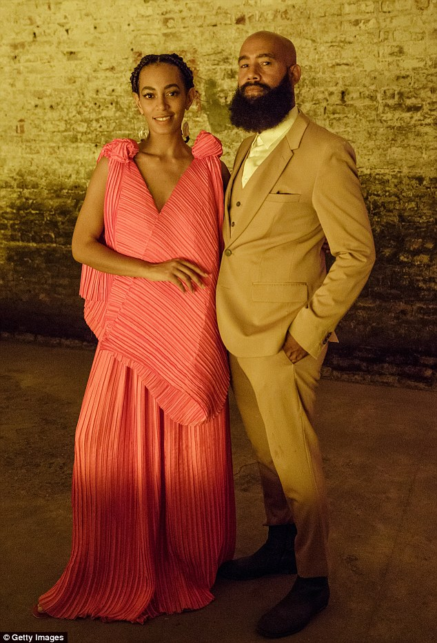 Proud moment: Solange wore a pleated salmon gown as she was joined by music video director husband Alan Ferguson at a listening party for her record in New Orleans on Friday