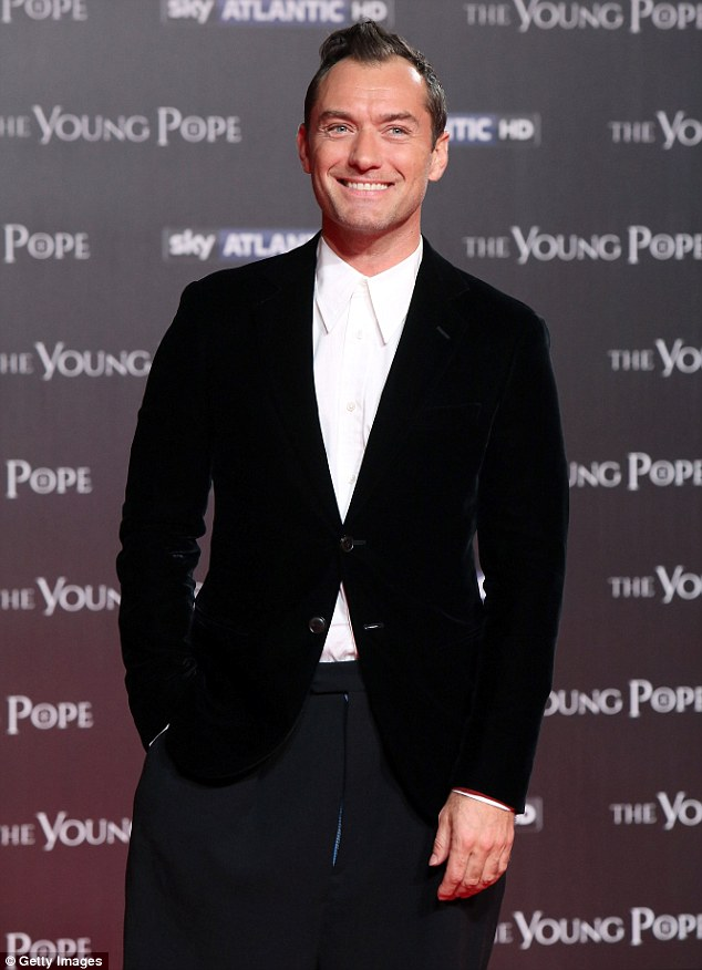 Looking good: Jude Law was suited and booted as he attended the premiere of his new TV drama, The Young Pope, in Rome on Sunday