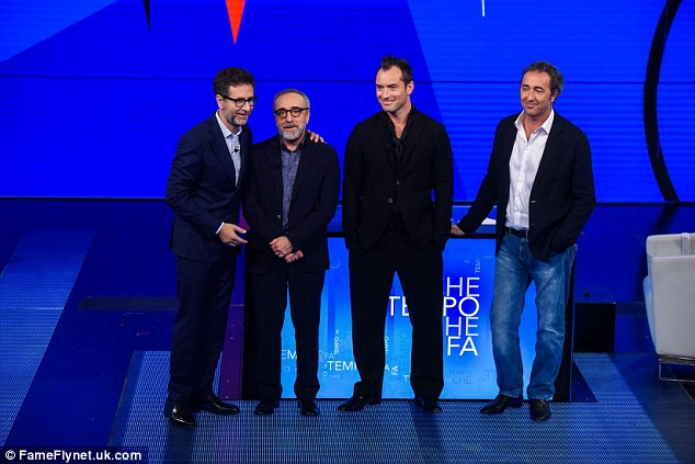 Taking to the stage: Fabio Fazio, Silvio Orlando, Jude and Paolo Sorrentino