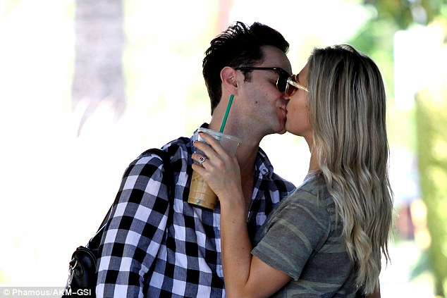 Hugs and kisses! Emma Slater and Sasha Farber passionately kissed during an outing in Los Angeles on Sunday, just days after becoming engaged