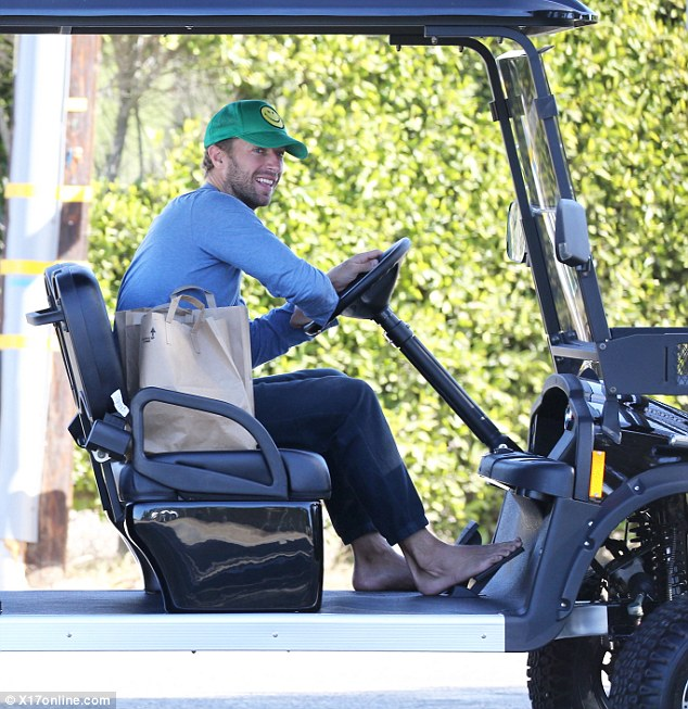 Laid-back dude: Chris Martin was spotted in Malibu going out for groceries in an over-sized golf cart on Sunday