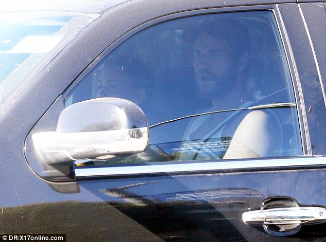 It's a date: Liam Hemsworth was seen in the drivers seat of the car alongside Miley