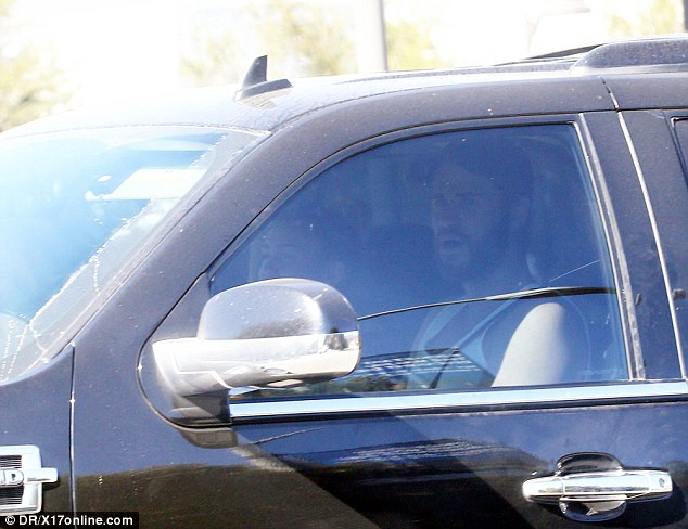 Private couple: A bearded Liam, 26, could be seen waiting in his black SUV with a baseball hat and tank top on