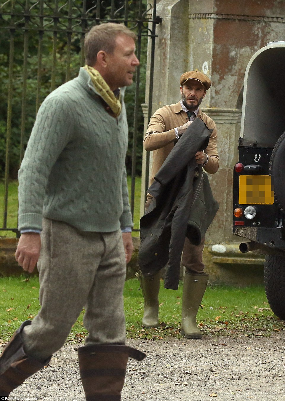 Passion for fashion: Wearing a long-sleeved taupe polo shirt over a crisp gingham shirt with an army green tie, the former England captian opted for perfectly-tailored trousers that fell seamlessly into his wellies