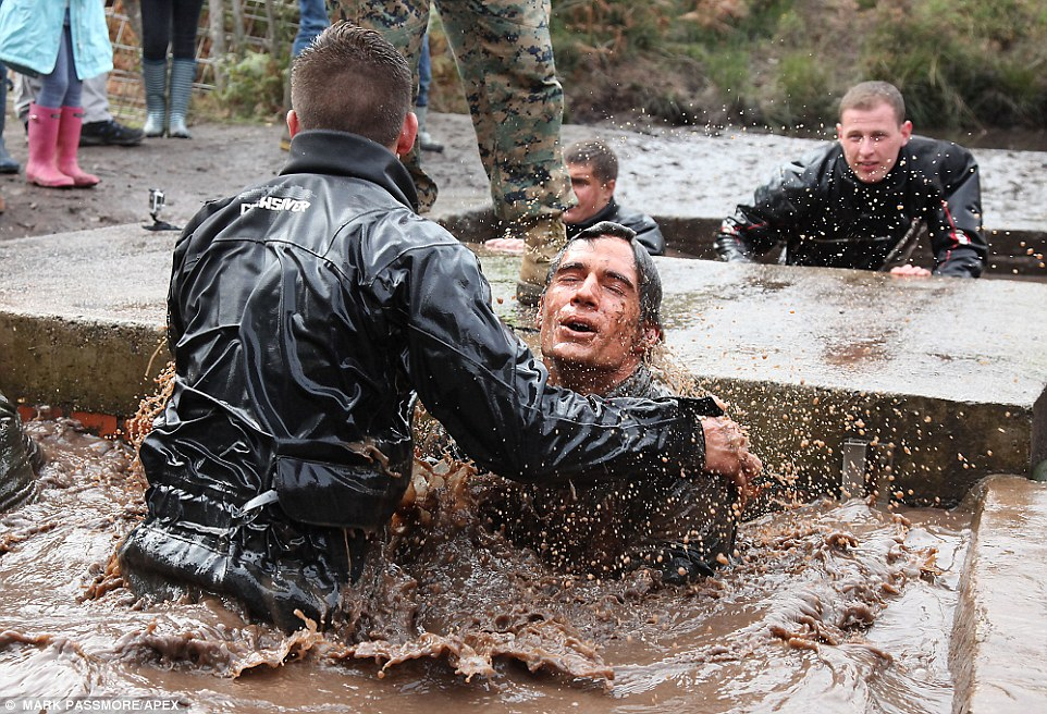 Ice cold: Henry closed his eyes to go under the so-called sheep dip, which even the hardest of Marines are scared of