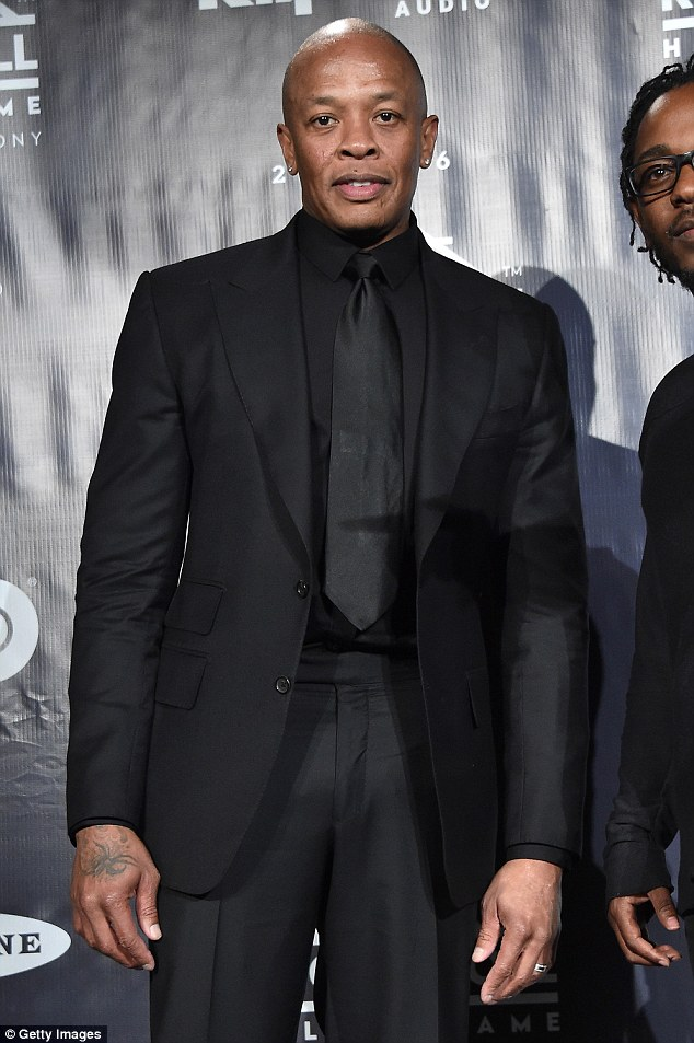 Dr. Dre has threatened to sue Sony Pictures if they release a TV movie depicting him as a woman beater (seen here in New York in April)