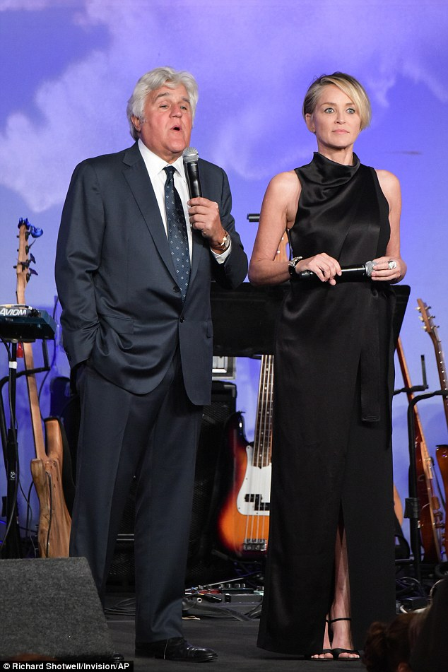 Hustling: The pair helped conduct the auction at the fundraiser